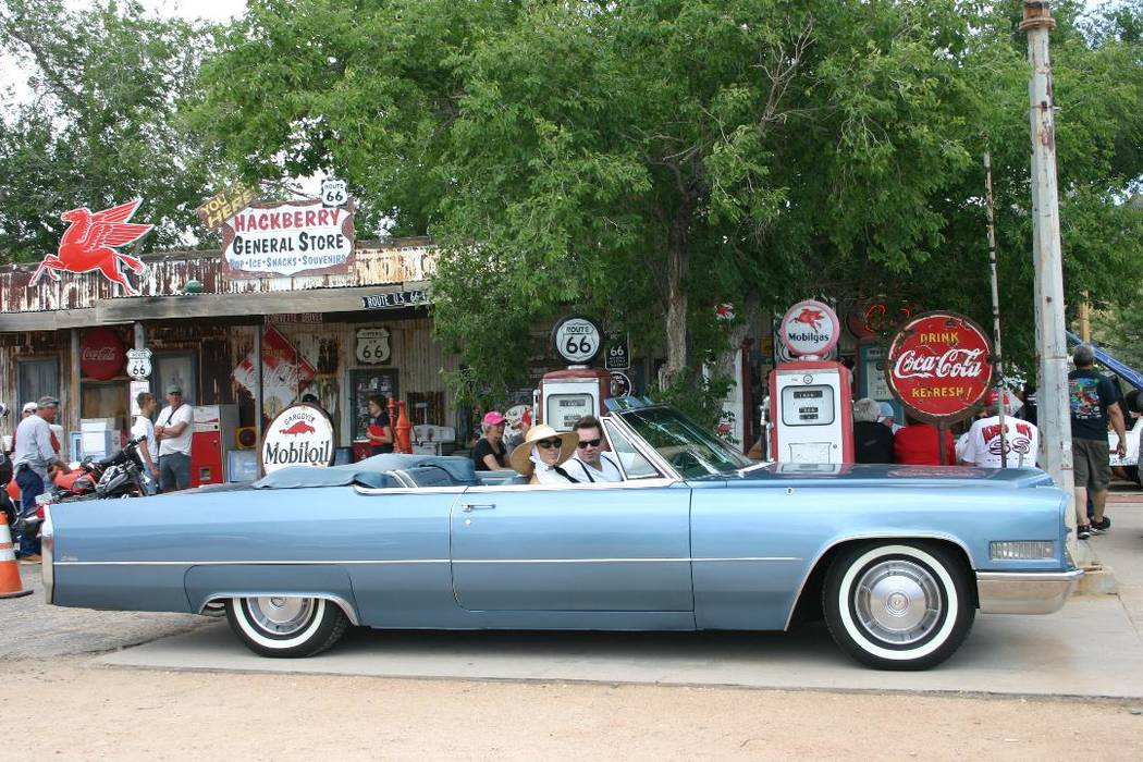 Findlay Las Vegas businessman Jared Anderson and his fiancée, Madelyn Feller, are seen in their classic 1966 Cadillac Deville convertible at Hackberry, Arizona.