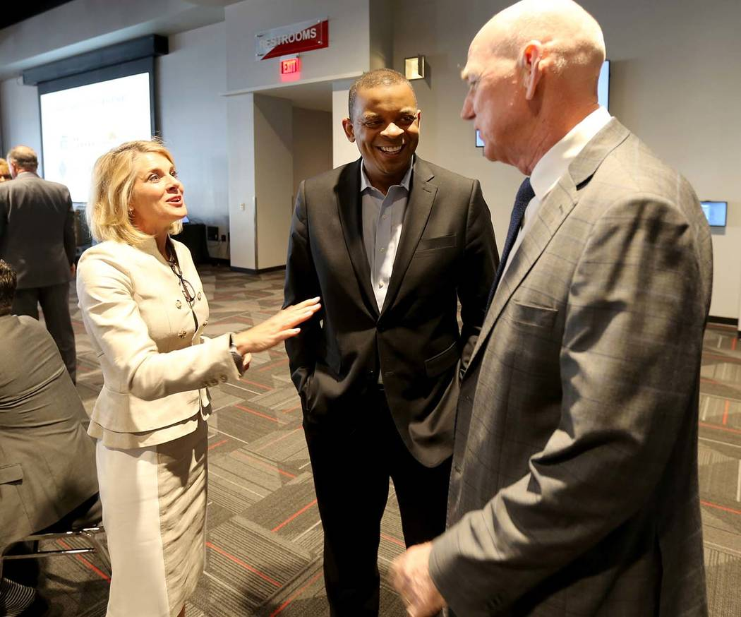 Former U.S. Secretary of Transportation and former Charlotte, N.C. Mayor Anthony Foxx, center, visits with Regional Transportation Commission General Manager Tina Quigley and Clark County Commissi ...