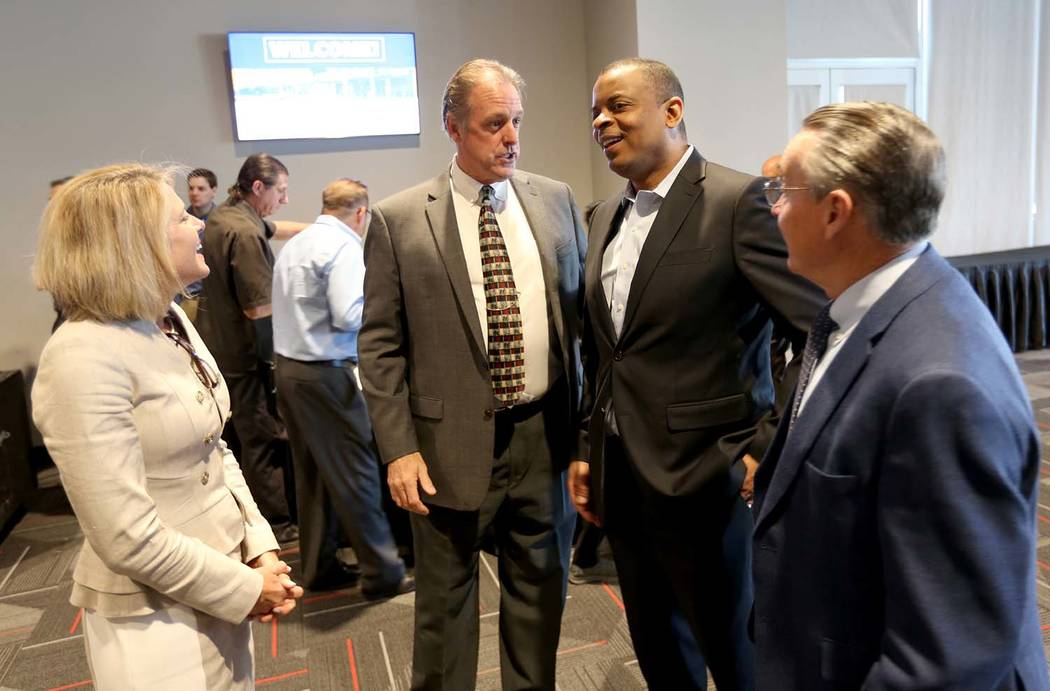 Former U.S. Secretary of Transportation and former Charlotte, N.C. Mayor Anthony Foxx, second from right, visits with Regional Transportation Commission General Manager Tina Quigley, North Las Veg ...