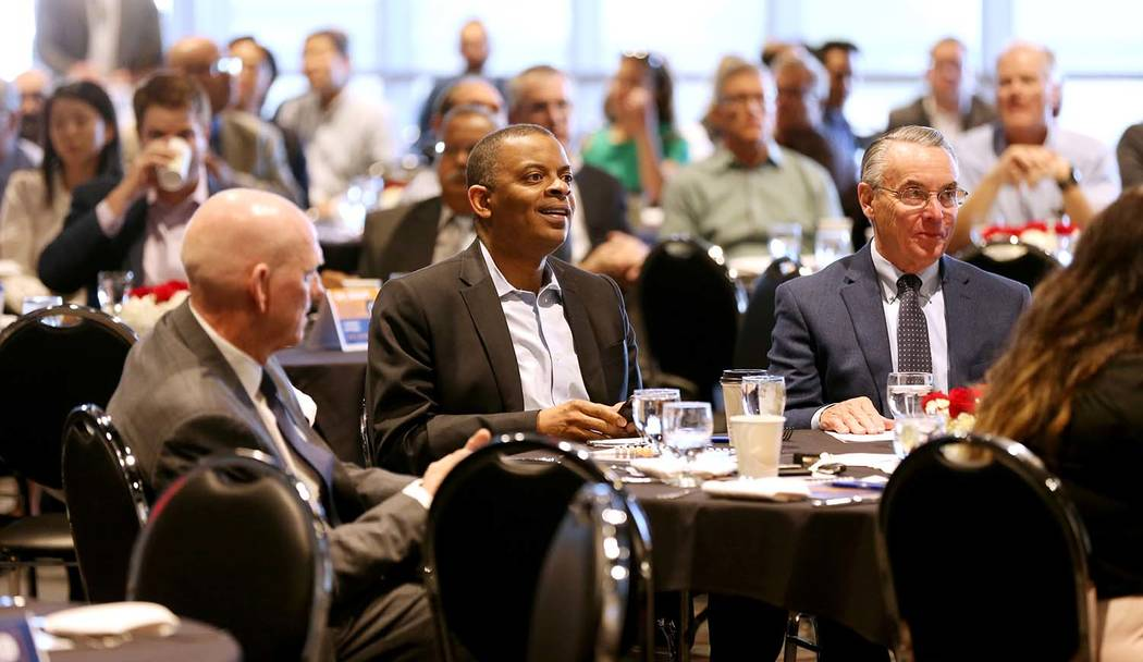 Former U.S. Secretary of Transportation and former Charlotte, N.C. Mayor Anthony Foxx, center, with Clark County Commissioner and RTC board Chairman Larry Brown, left, and executive and philanthro ...