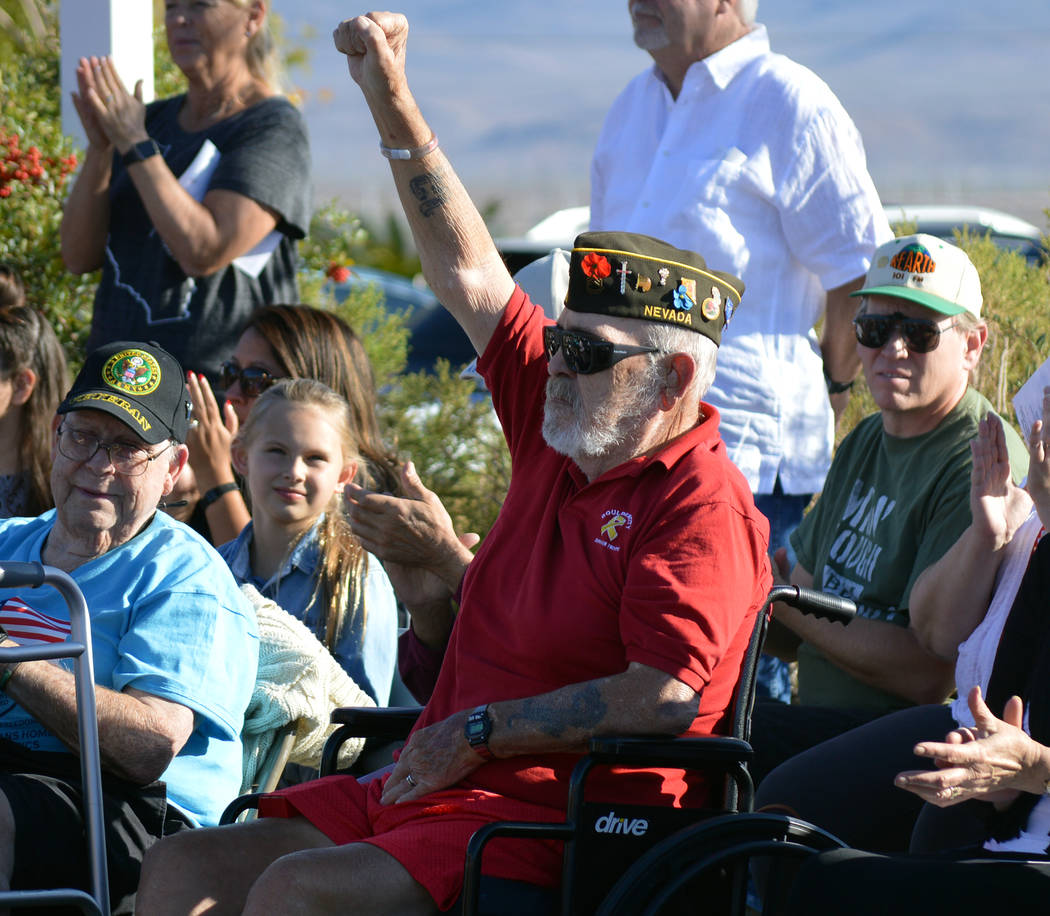 Celia Shortt Goodyear/Boulder City Review U.S. Army Sgt. 1st Class James Duffin raises his hand and is recognized at the Veterans Day ceremony at the Nevada State Veterans Home on Saturday for his ...