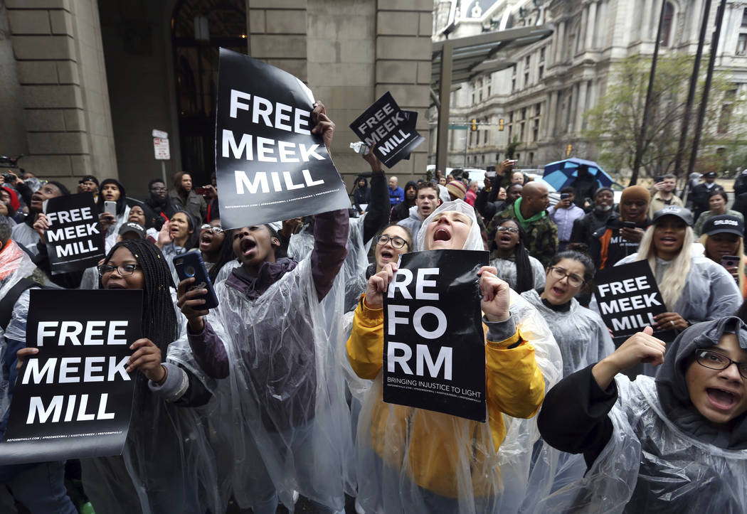 Protesters demonstrate in front of a courthouse during a hearing for rapper Meek Mill, Monday April 16, 2018 in Philadelphia. (AP Photo/Jacqueline Larma)