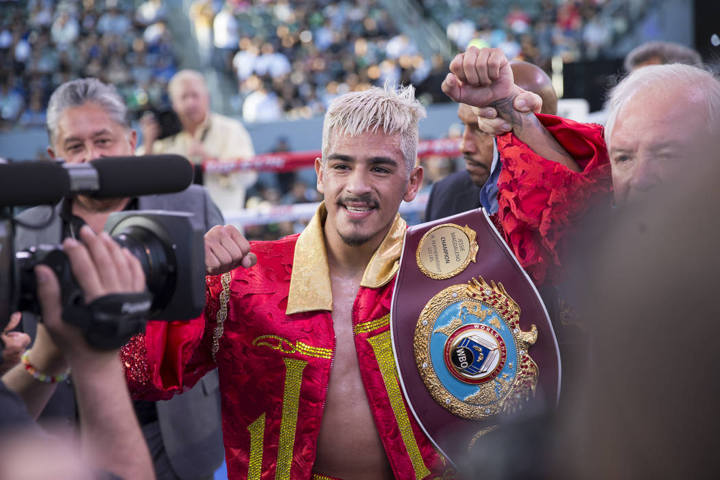 Jessie Magdaleno celebrates his second round knockout win against Adeilson Dos Santos in their WBO World Championship super bantamweight bout at the StubHub Center on Saturday, April 22, 2017, in ...