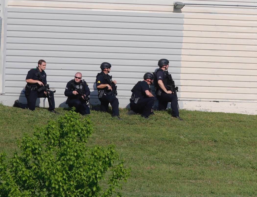 Dallas Police look for a suspect in the shooting of two police officers Tuesday afternoon April, 24,2018. Police are near ExtraSpace Storage, south of Home Depot. (Ron Baselice/The Dallas Morning ...