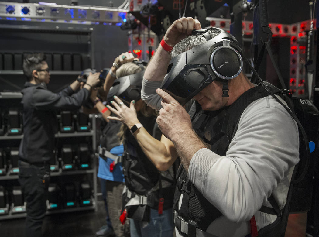 """Buzz Harrison, right, gets his gear straightened out before the start of the new """"Star Wars: Secrets of the Empire"""" VR experience at the Grand Canal Shoppes on Tuesday, April 24, 2018, i ..."""