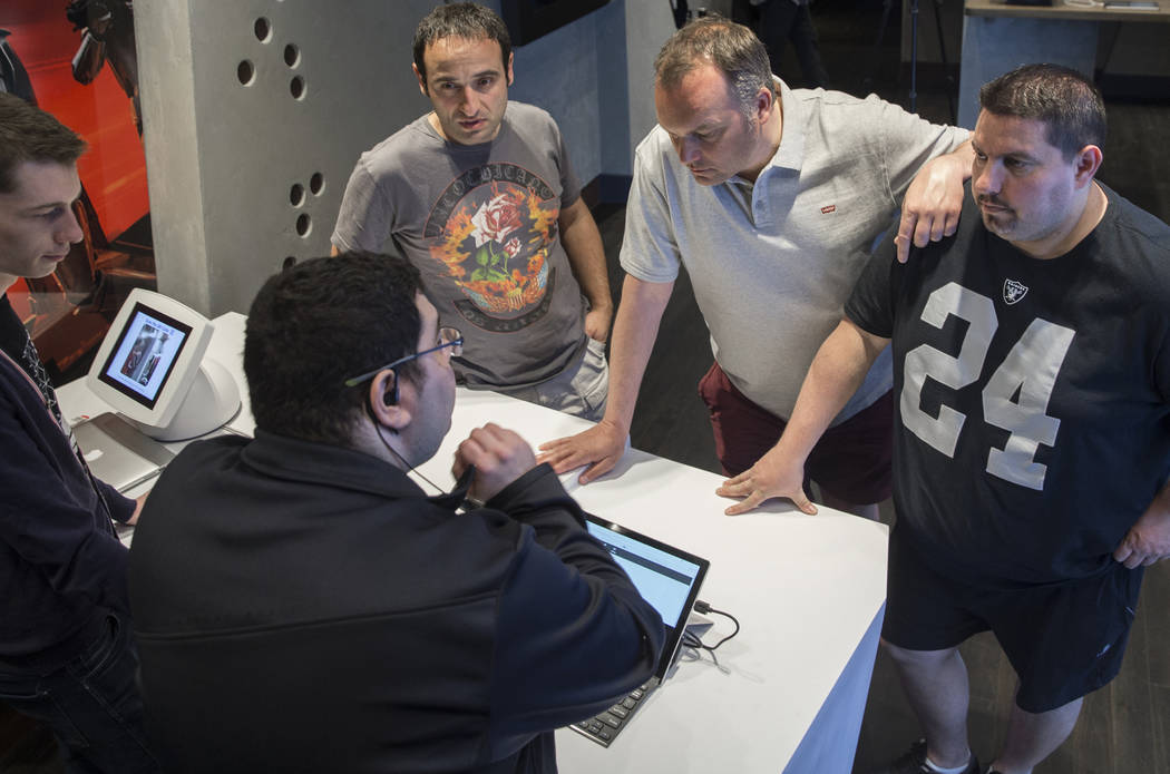 """Camillo Loz, left, Rodolphe Billon and Johnny Rodriguez choose a time slot to start the new """"Star Wars: Secrets of the Empire"""" VR experience at the Grand Canal Shoppes on Tuesday, April ..."""