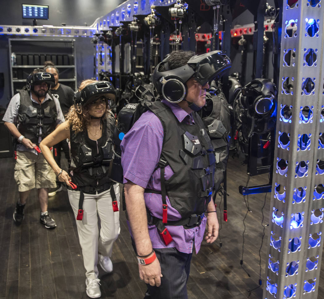 """Guests are escorted into the waiting area before the start of the new """"Star Wars: Secrets of the Empire"""" VR experience at the Grand Canal Shoppes on Tuesday, April 24, 2018, in Las Vegas ..."""