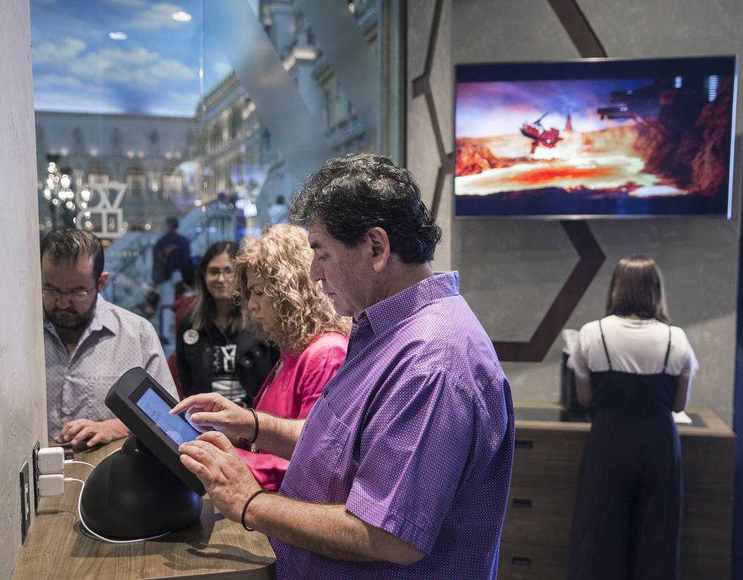 """Guests sign in during a sneak peak at the new """"Star Wars: Secrets of the Empire"""" VR experience at the Grand Canal Shoppes on Tuesday, April 24, 2018, in Las Vegas. Benjamin Hager Las Veg ..."""