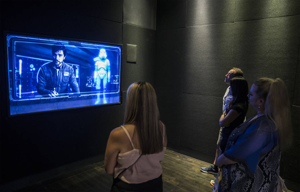 """Guests listen to an introduction before gearing up for the new """"Star Wars: Secrets of the Empire"""" VR experience at the Grand Canal Shoppes on Tuesday, April 24, 2018, in Las Vegas. Benja ..."""