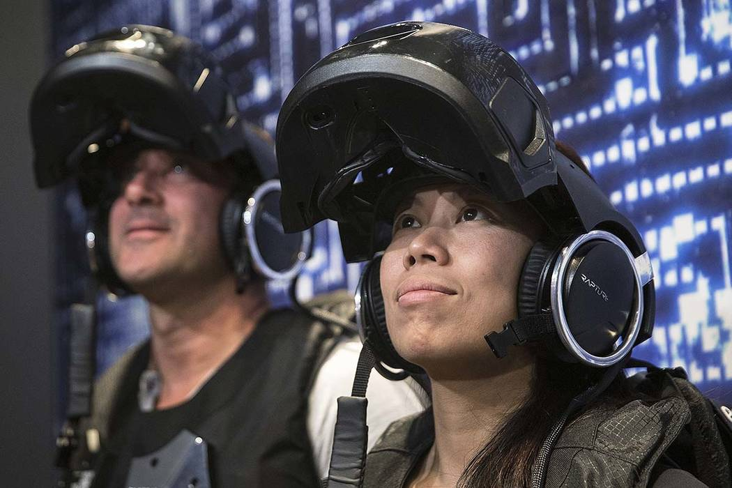 """Vicki Li, right, waits to begin the new """"Star Wars: Secrets of the Empire"""" VR experience at the Grand Canal Shoppes on Tuesday, April 24, 2018, in Las Vegas. (Benjamin Hager/Las Vegas Review-Journ ..."""