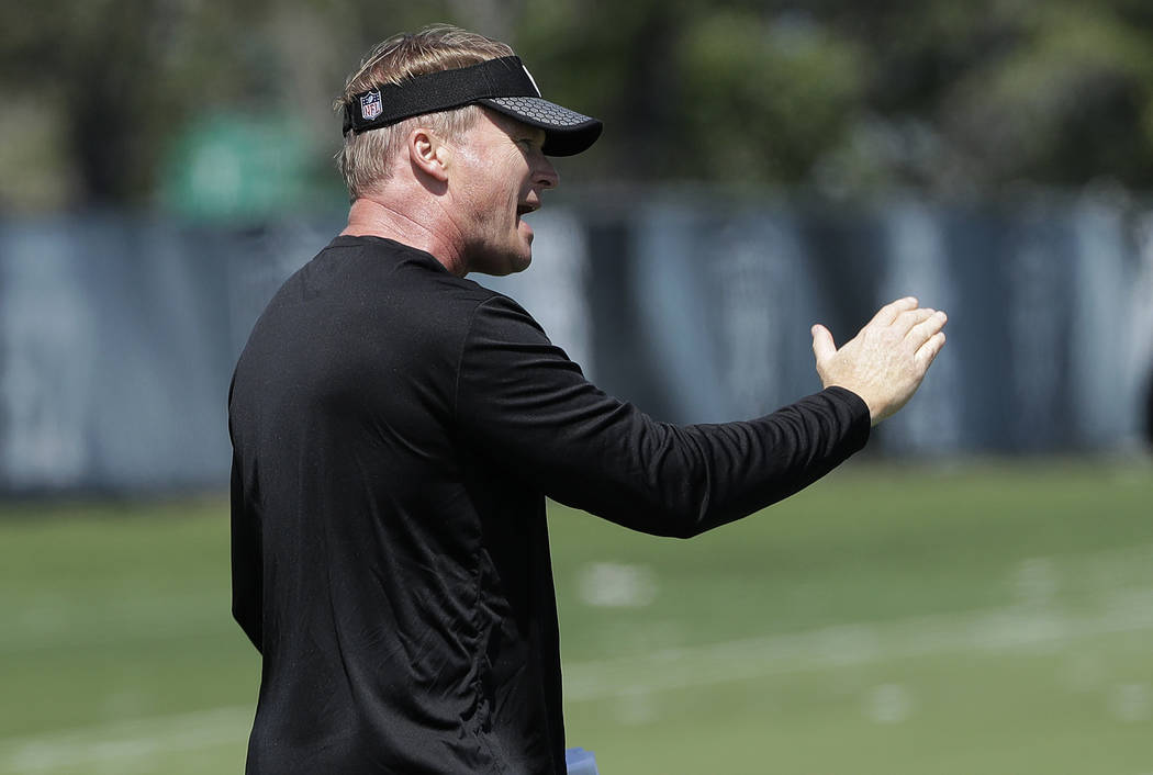 Oakland Raiders head coach Jon Gruden gestures at the team's NFL football facility in Alameda, Calif., Tuesday, April 24, 2018. (AP Photo/Jeff Chiu)