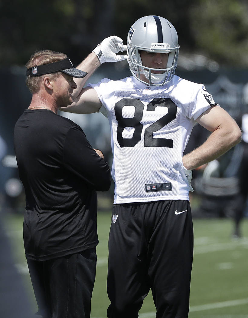 Oakland Raiders head coach Jon Gruden, left, talks with wide receiver Jordy Nelson at the team's NFL football facility in Alameda, Calif., Tuesday, April 24, 2018. (AP Photo/Jeff Chiu)