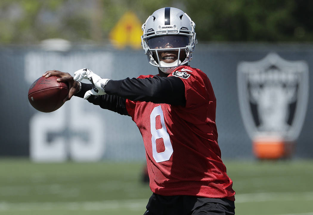 Oakland Raiders quarterback Josh Johnson passes during practice at the team's NFL football facility in Alameda, Calif., Tuesday, April 24, 2018. (AP Photo/Jeff Chiu)