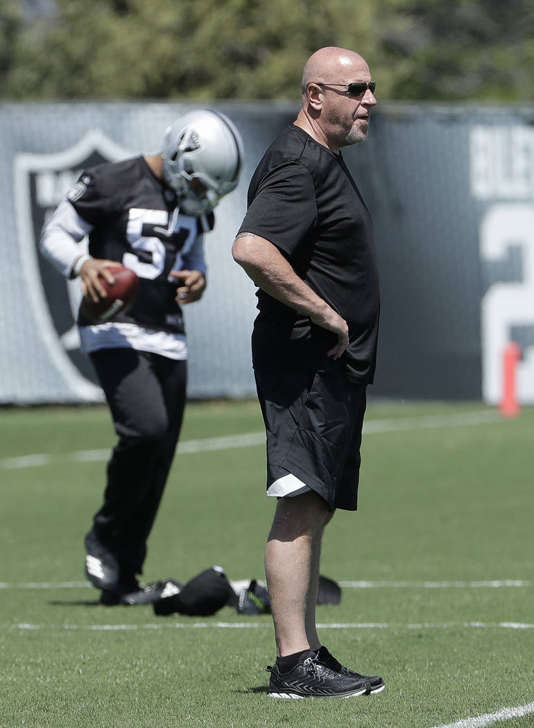 Oakland Raiders offensive line coach Tom Cable watches as players warm up during practice at the team's NFL football facility in Alameda, Calif., Tuesday, April 24, 2018. (AP Photo/Jeff Chiu)
