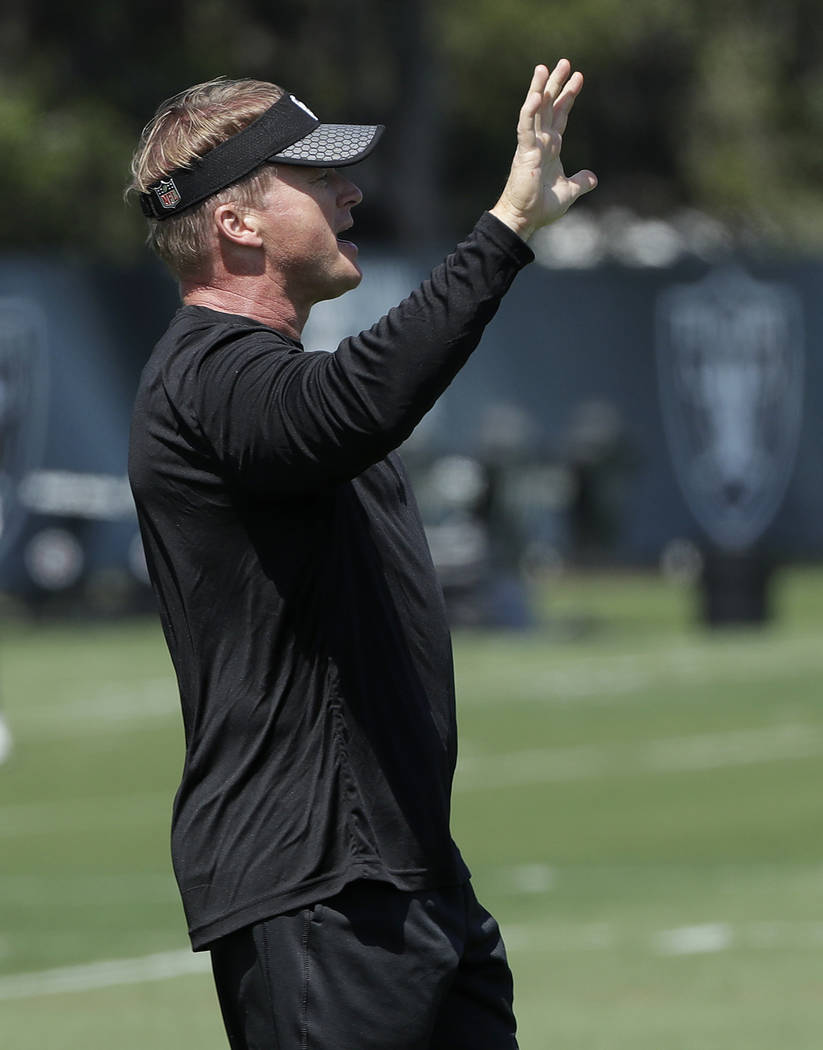 Oakland Raiders head coach Jon Gruden gestures at the team's football facility in Alameda, Calif., Tuesday, April 24, 2018. (AP Photo/Jeff Chiu)