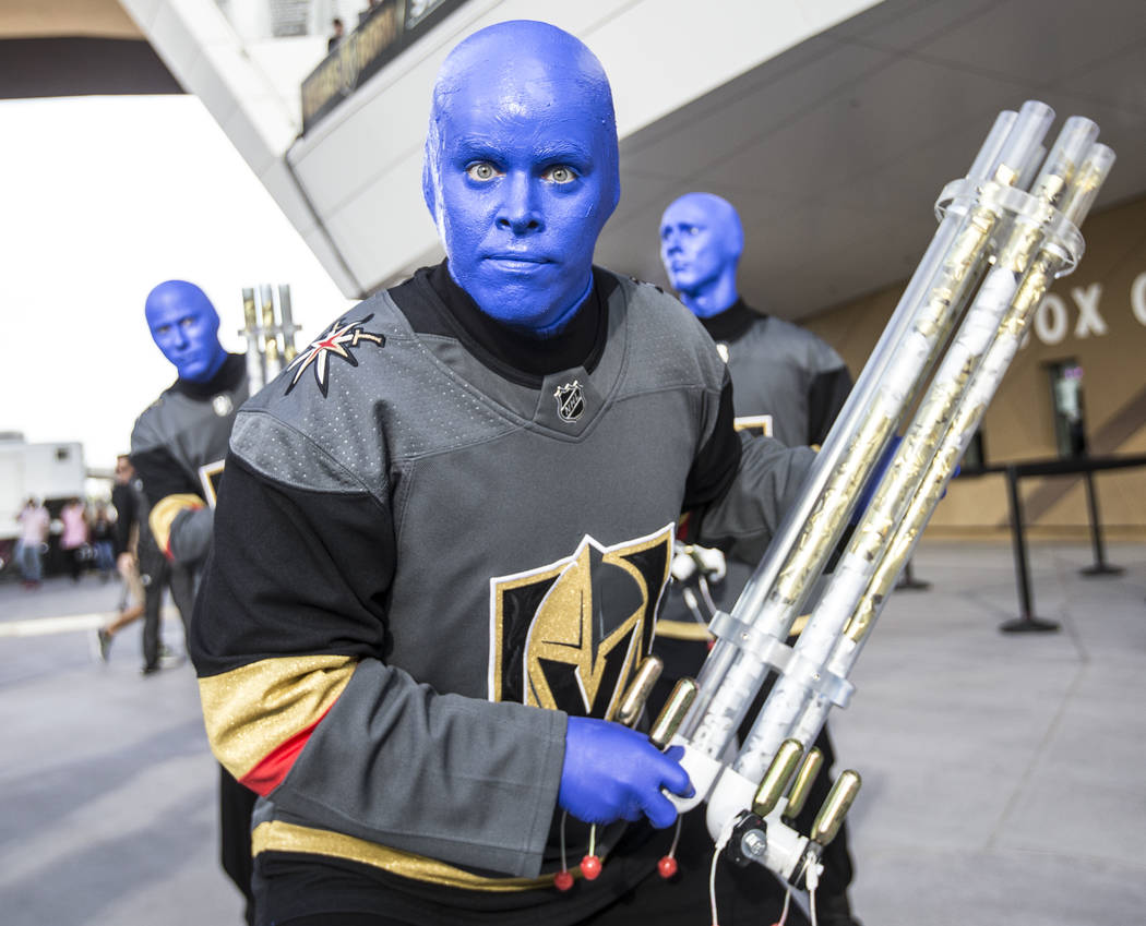 The Blue Man Group performs outside T-Mobile Arena before the start of the Golden Knights first round playoff game with the Los Angeles Kings at Toshiba Plaza on Wednesday, April 11, 2018, in Las ...