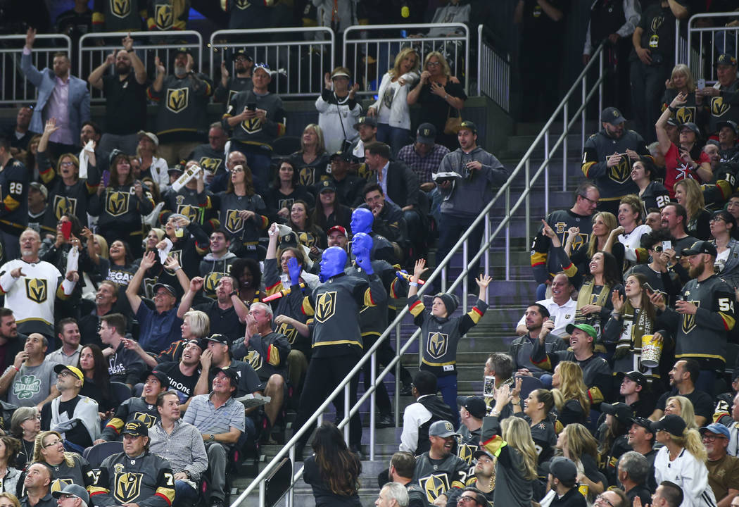 The Blue Man Group entertains fans during the third period of Game 1 of an NHL hockey first-round playoff series between the Golden Knights and the Los Angeles Kings at T-Mobile Arena in Las Vegas ...
