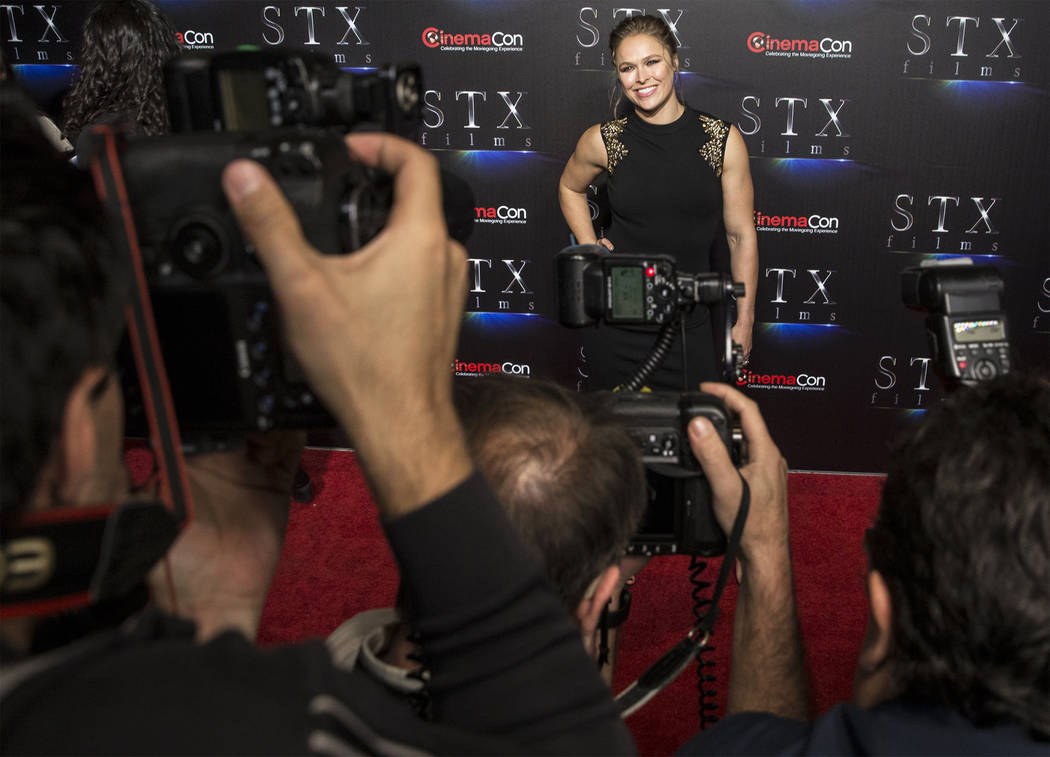 Ronda Rousey takes photos during the STXfilms red carpet event on the second night of CinemaCon on Tuesday, April 24, 2018, at Caesars Palace hotel-casino, in Las Vegas. Benjamin Hager Las Vegas R ...