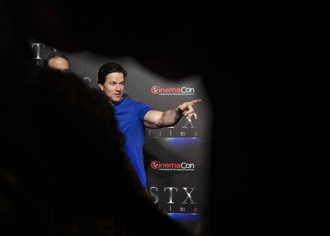 Mark Wahlberg takes photos during the STXfilms red carpet event on the second night of CinemaCon on Tuesday, April 24, 2018, at Caesars Palace hotel-casino, in Las Vegas. Benjamin Hager Las Vegas ...