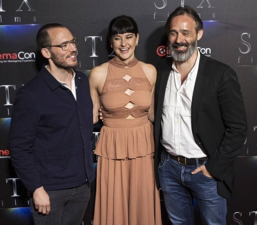 Sam Claflin, left, Shailene Woodley and Director Baltasar Kormkur take photos during the STXfilms red carpet event on the second night of CinemaCon on Tuesday, April 24, 2018, at Caesars Palace ho ...