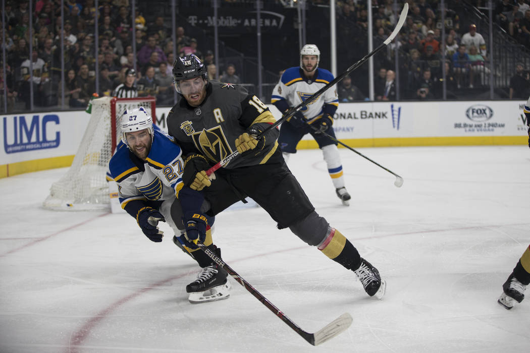 St. Louis Blues defenseman Alex Pietrangelo (27) and Vegas Golden Knights left wing James Neal (18) go for the puck during the first period of an NHL hockey game at T-Mobile Arena in Las Vegas, Fr ...