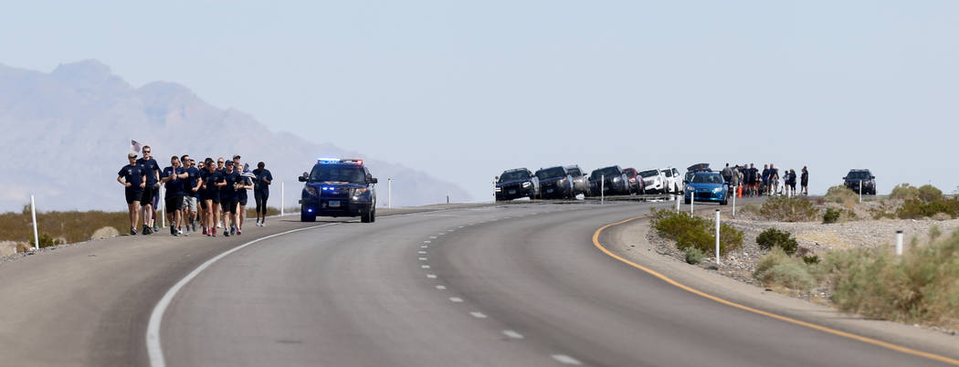 Runners make their way north on U.S. Highway 95 near Indian Springs during the Law Enforcement Officers Memorial Run Wednesday, April 25, 2018. Police officers and others are on a 430-mile relay r ...