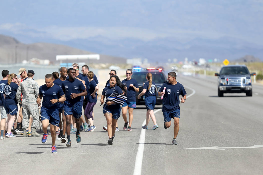 Runners make their way north on U.S. Highway 95 at Indian Springs during the Law Enforcement Officers Memorial Run Wednesday, April 25, 2018. Police officers and others are on a 430-mile relay run ...