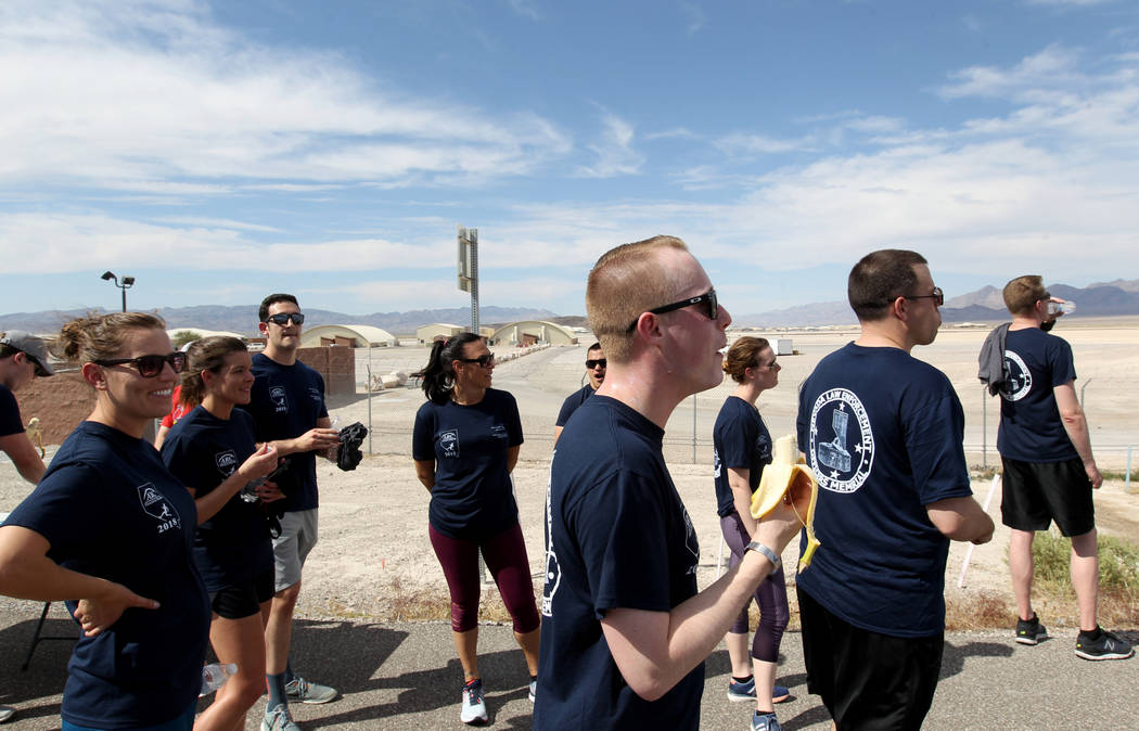Members of the U.S. Air Force re-fuel and watch for fellow runners after running north on U.S. Highway 95 at Indian Springs during the Law Enforcement Officers Memorial Run Wednesday, April 25, 20 ...