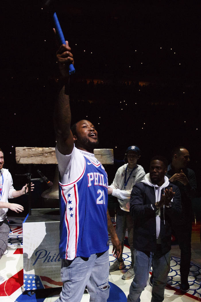Rapper Meek Mill comes out to ring a Liberty Bell replica before the first half in Game 5 of a first-round NBA basketball playoff series between the Miami Heat and the Philadelphia 76ers, Tuesday, ...