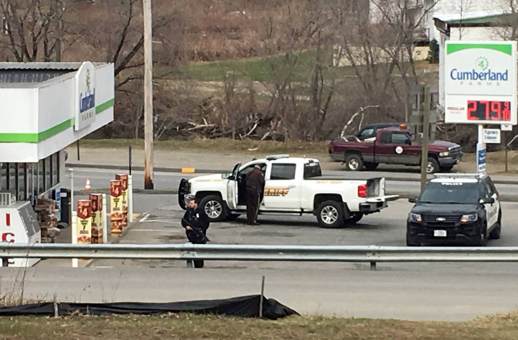 Officers work the scene of a shooting at a Cumberland Farms convenience store in Norridgewock, Maine, Wednesday, April 25, 2018. A Maine man killed a sheriff's deputy, stole his cruiser and robbed ...