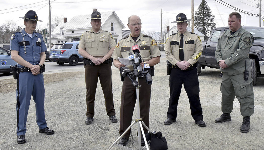 Somerset County Sheriff Dale Lancaster, center, speaks with the media, Wednesday, April 25, 2018, in Norridgewock, Maine, after deputy Eugene Cole was killed overnight. (David Leaming/The Central ...