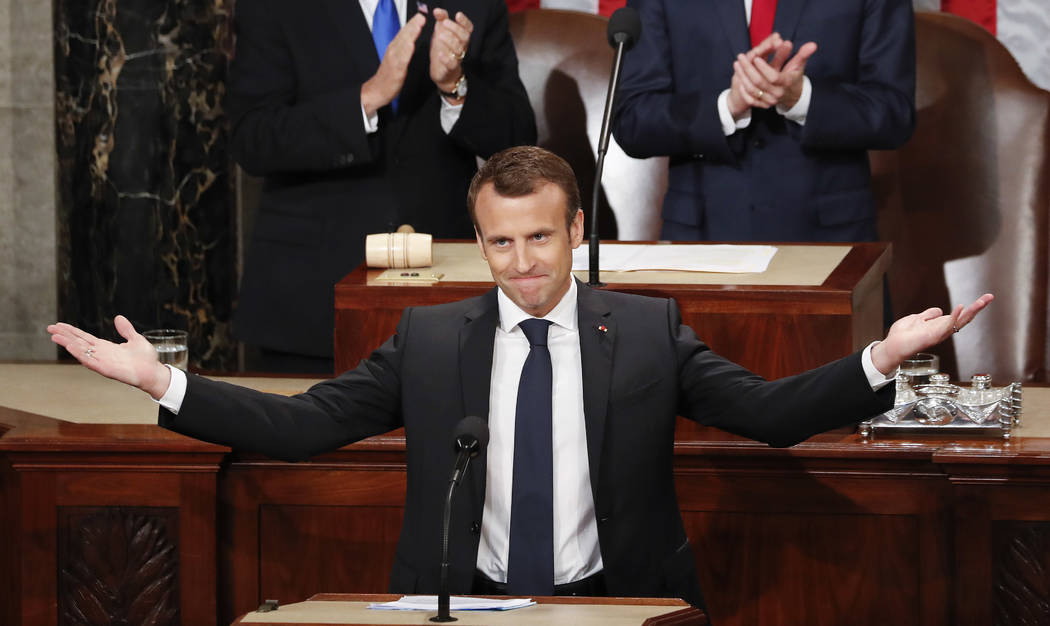 French President Emmanuel Macron gestures as he is introduced before speaking to a joint meeting of Congress on Capitol Hill in Washington, Wednesday, April 25, 2018.(AP Photo/Pablo Martinez Monsi ...