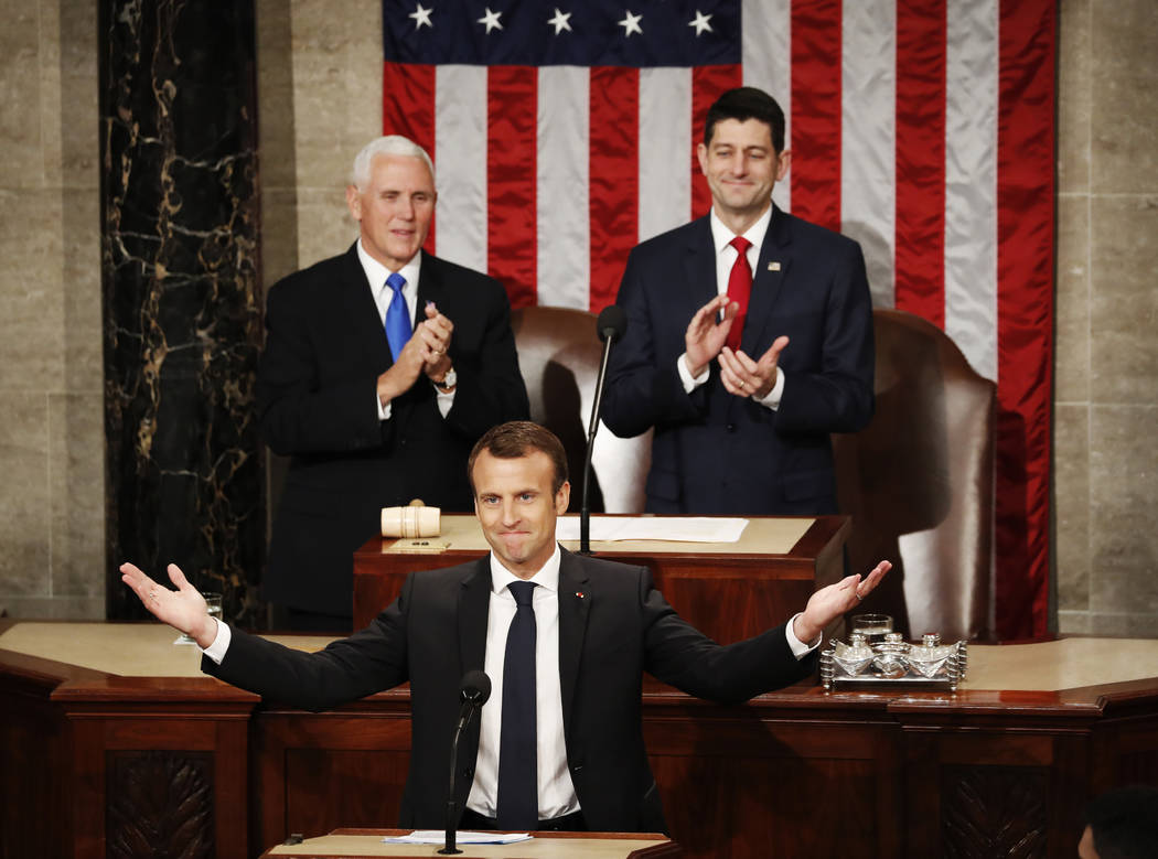 French President Emmanuel Macron gestures as he arrives for his address to a joint meeting of Congress on Capitol Hill in Washington, Wednesday, April 25, 2018. (Pablo Martinez Monsivais/AP)
