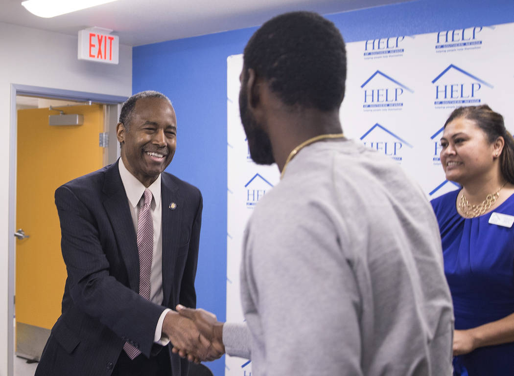 Ben Carson, left, Secretary of Housing and Urban Development, shakes hands with resident Toby O'Neal at the conclusion of a round table discussion at Shannon West Center for Homeless Youth on Wedn ...
