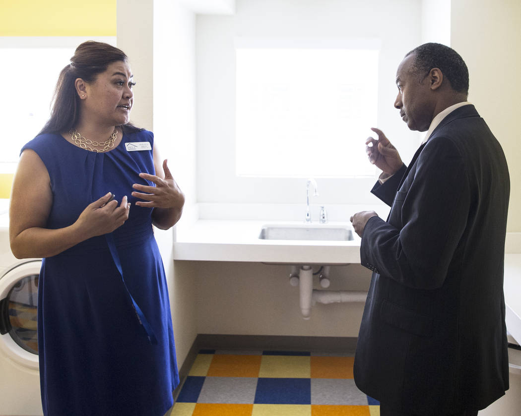 Ben Carson, right, Secretary of Housing and Urban Development, speaks with Fuilala Riley of HELP of Southern Nevada during a tour of Shannon West Center for Homeless Youth on Wednesday, April 25, ...