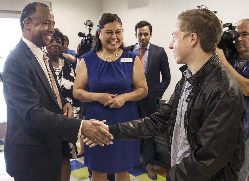 Ben Carson, left, Secretary of Housing and Urban Development, shakes hands with resident Daniel Sandoval-Collins during a tour of Shannon West Center for Homeless Youth on Wednesday, April 25, 201 ...