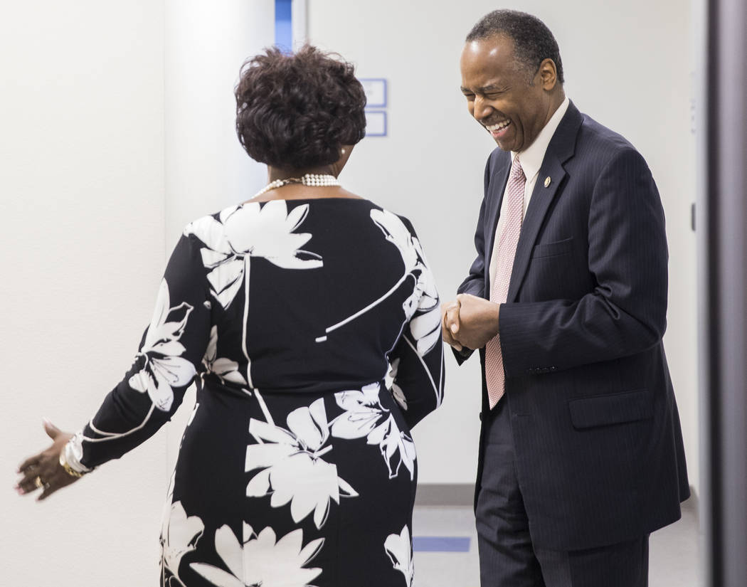 Ben Carson, right, Secretary of Housing and Urban Development, shares a laugh with Jerrie Merritt of HELP of Southern Nevada during a tour of Shannon West Center for Homeless Youth on Wednesday, A ...