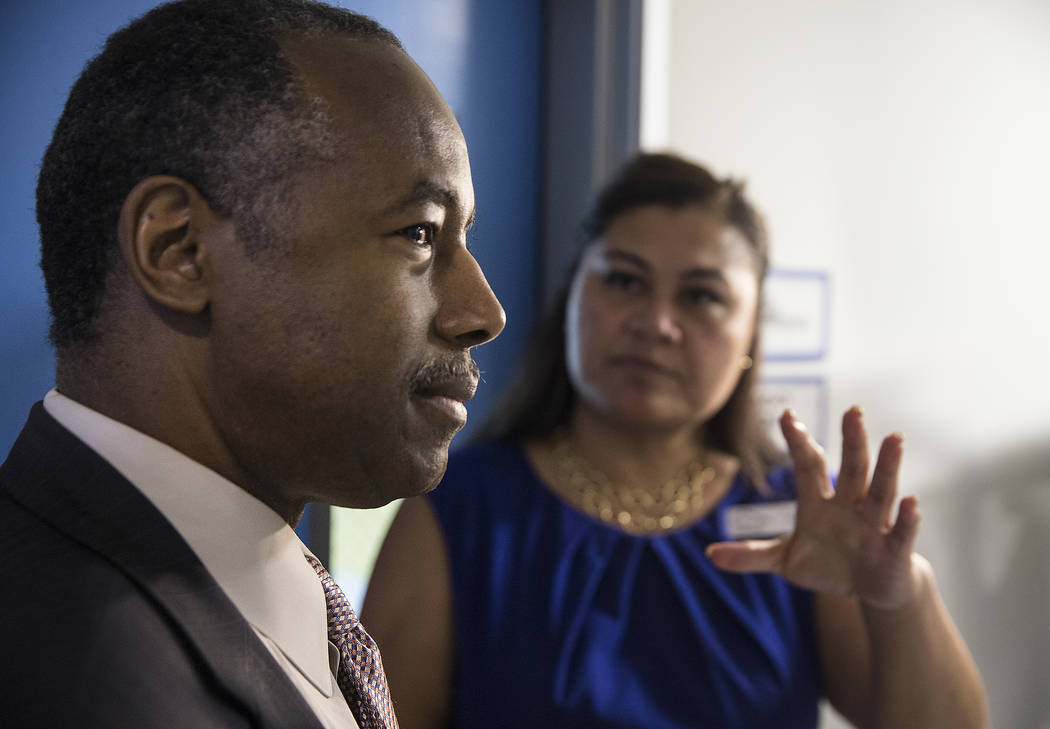 Ben Carson, left, Secretary of Housing and Urban Development, speaks with Fuilala Riley of HELP of Southern Nevada during a tour of Shannon West Center for Homeless Youth on Wednesday, April 25, 2 ...