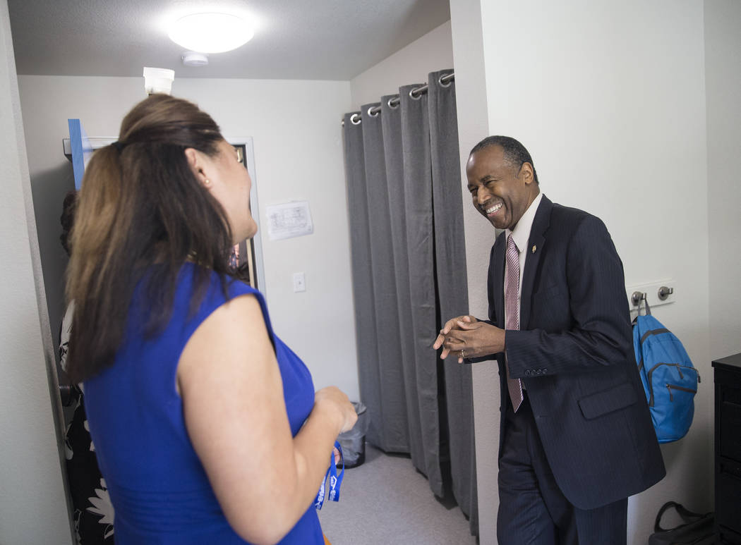 Ben Carson, right, Secretary of Housing and Urban Development, shares a laugh with Fuilala Riley of HELP of Southern Nevada during a tour of Shannon West Center for Homeless Youth on Wednesday, Ap ...