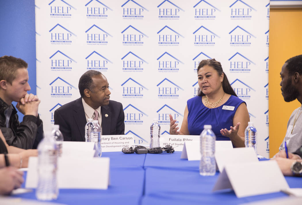 Ben Carson, left, Secretary of Housing and Urban Development, listens to Fuilala Riley of HELP of Southern Nevada during a round table discussion at Shannon West Center for Homeless Youth on Wedne ...