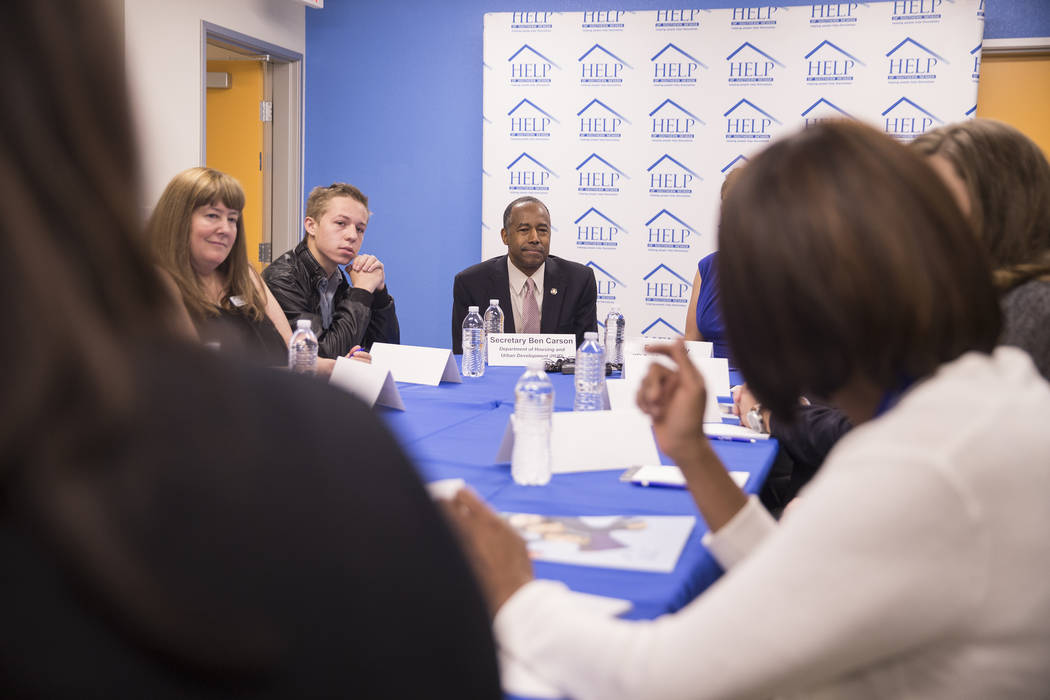 Ben Carson, middle, Secretary of Housing and Urban Development, participates in a round table discussion at Shannon West Center for Homeless Youth on Wednesday, April 25, 2018, in Las Vegas. Benja ...