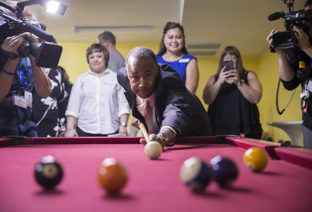 Ben Carson, Secretary of Housing and Urban Development, plays pool with resident Terrance McCoy during a tour of Shannon West Center for Homeless Youth on Wednesday, April 25, 2018, in Las Vegas. ...