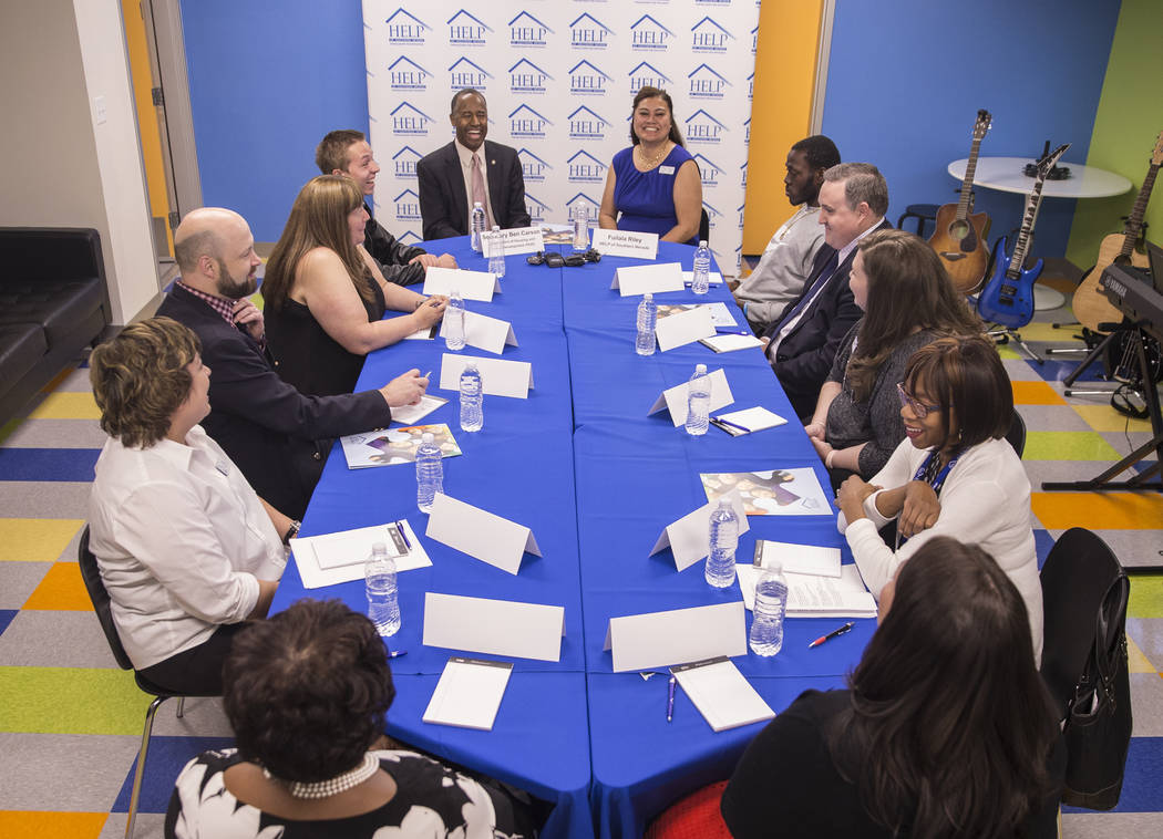 Ben Carson, left/back, Secretary of Housing and Urban Development, listens to input during a round table discussion at Shannon West Center for Homeless Youth on Wednesday, April 25, 2018, in Las V ...