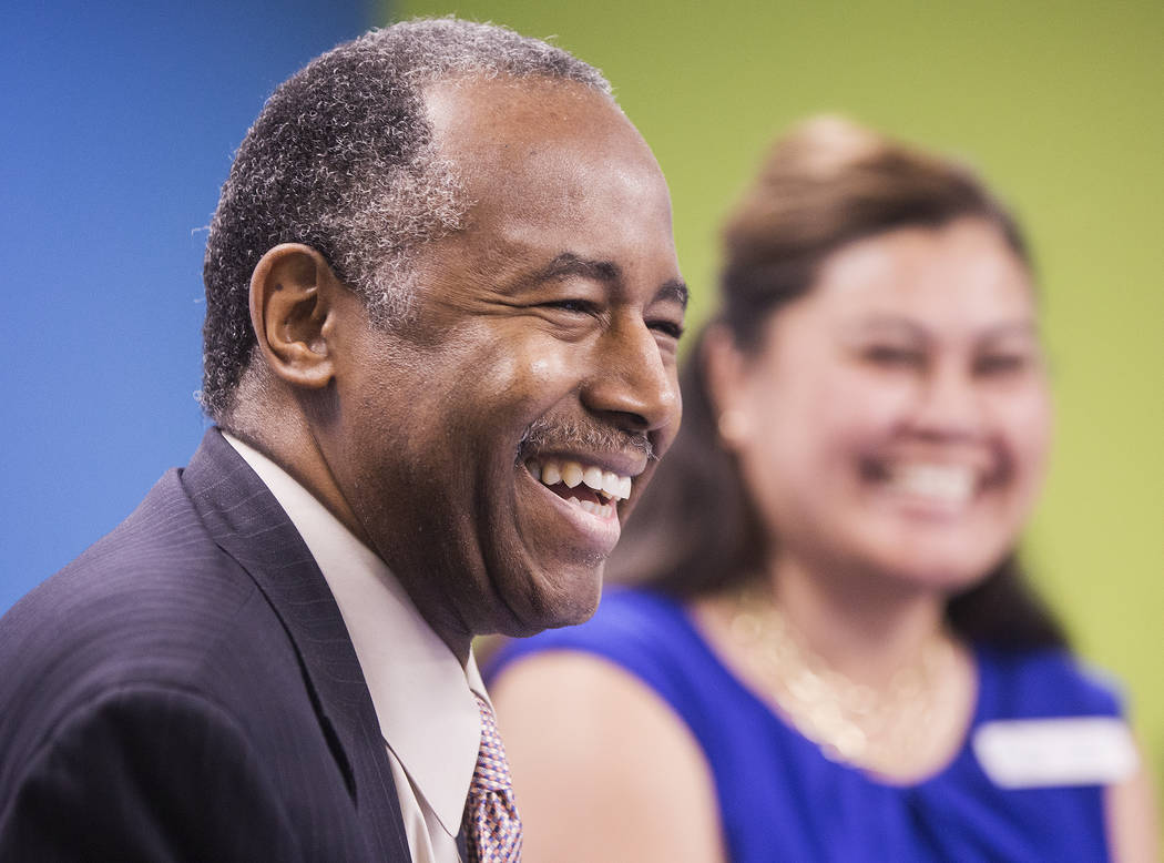 Ben Carson, left, Secretary of Housing and Urban Development, shares a laugh with Fuilala Riley of HELP of Southern Nevada during a tour of Shannon West Center for Homeless Youth on Wednesday, Apr ...