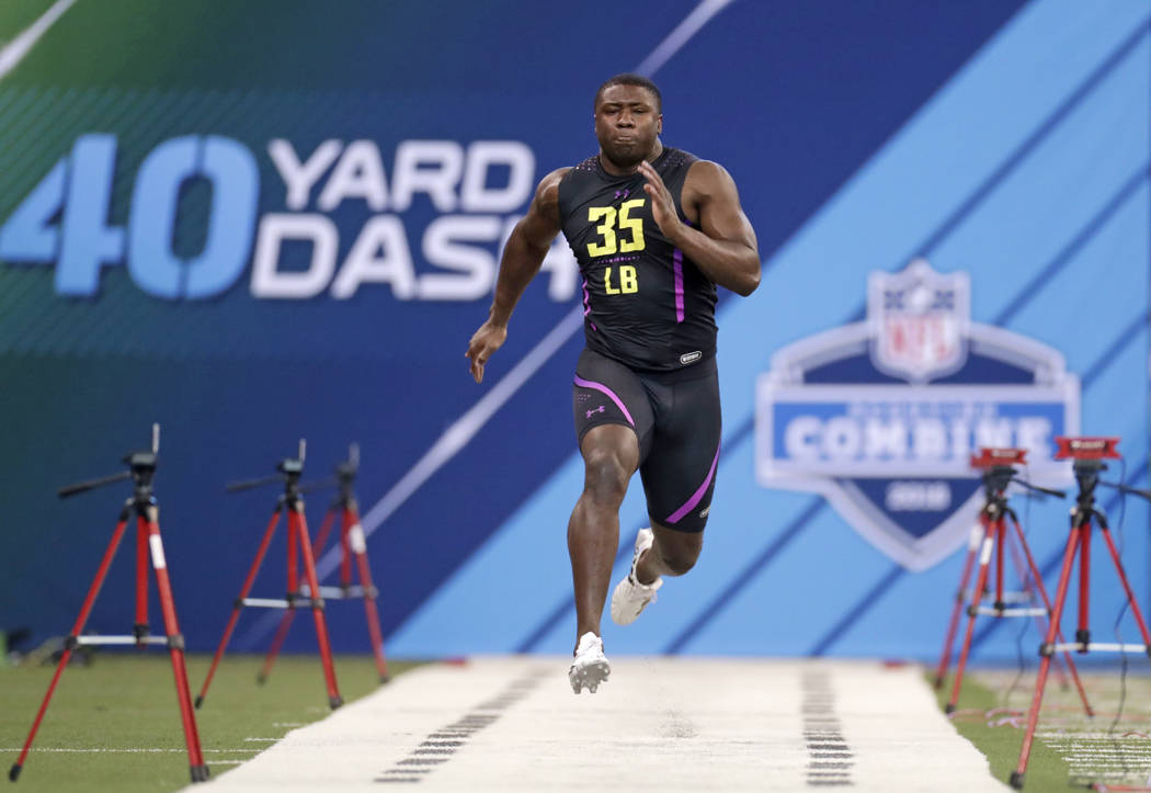 Georgia linebacker Roquan Smith runs the 40-yard dash at the NFL football scouting combine in Indianapolis, Sunday, March 4, 2018. (AP Photo/Michael Conroy)