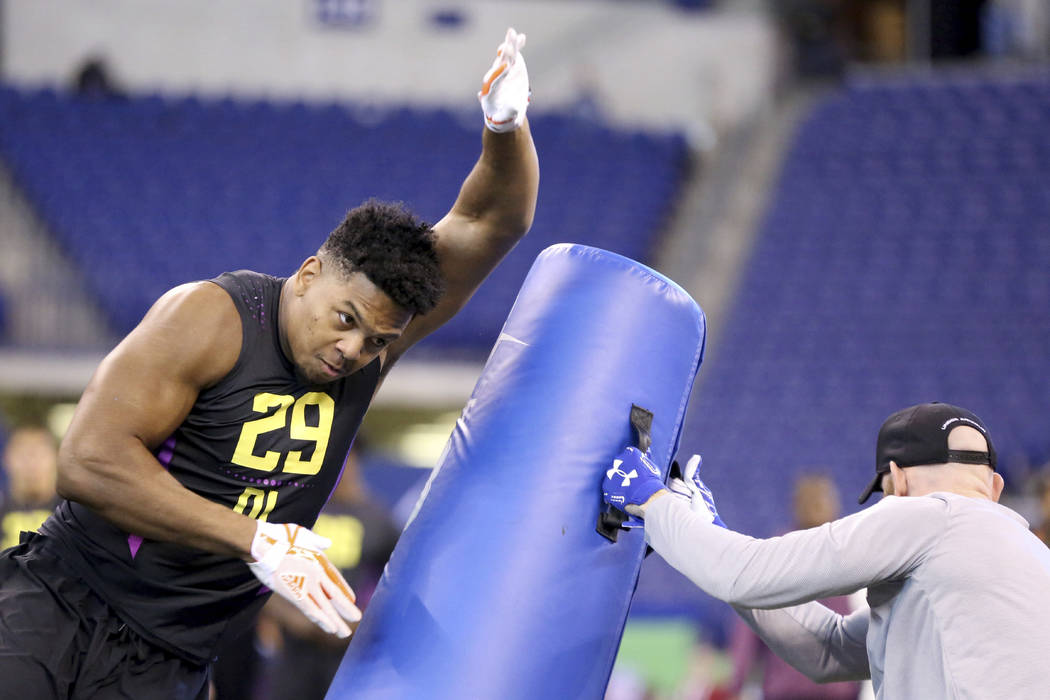 UTSA defensive lineman Marcus Davenport performs in a drill seen at the 2018 NFL Scouting Combine on Sunday, March 4, 2018, in Indianapolis. (AP Photo/Gregory Payan)