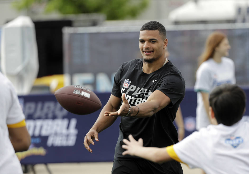 NFL Draft prospect Alabama defensive back Minkah Fitzpatrick tosses the ball during a Play Football Clinic Wednesday, April 25, 2018, in Arlington, Texas. The 2018 NFL Draft begins Thursday, April ...