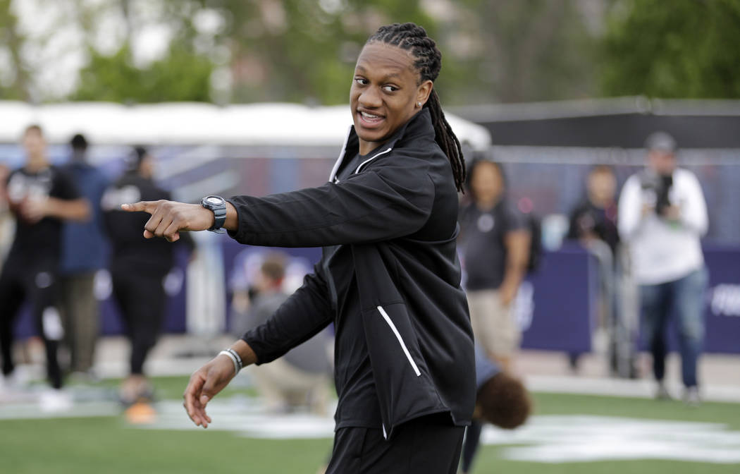 NFL Draft prospect Virginia Tech's Tremaine Edmunds gives instructions to participants during a Play Football Clinic Wednesday, April 25, 2018, in Arlington, Texas. The 2018 NFL Draft begins Thurs ...