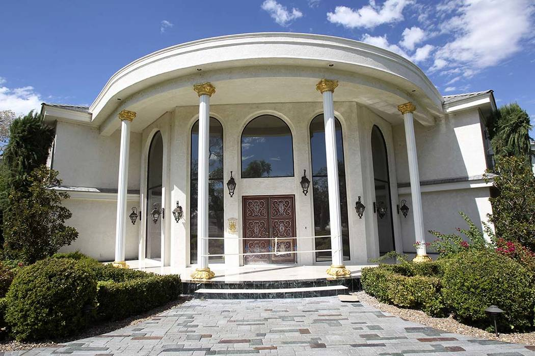 The front of Wayne Newton's former residence shown at the estate of the former Strip headliner Tuesday, Aug. 27, 2013. The majority owners of the 38-acre site at the corner of Sunset and Pecos roa ...