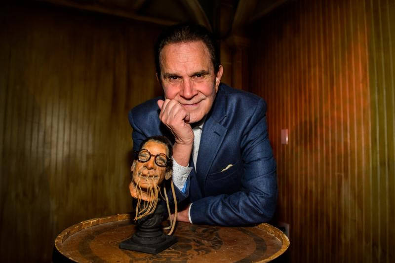 Rich Little, shown with his new shrunken head at Golden Tiki on Tuesday, April 24, 2018. (Brenton Ho)